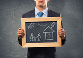 Businessman with frame with family sketches — Stock Photo