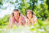Couple in park listening music — Stock Photo