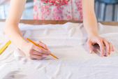 Tailors hands drawing with pencil — Stock Photo