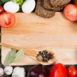 Vegetables and spices on kitchen table — Stock Photo #65249835