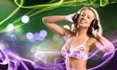 Girl in white bikini and headphones — Stock Photo