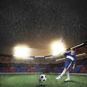 Boy football player at stadium — Stock Photo