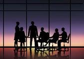 Businessteam sitting round table — Stockfoto