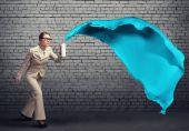 Businesswoman using spray — Stock Photo