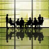 Businessteam sitting round table — Stock Photo