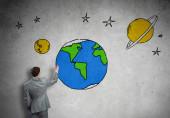 Zakenman voorstellende getekende Aarde planeet — Stockfoto