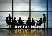 Businessteam sitting round table — Foto de Stock