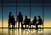 Silhouttes of business people at work — Stock Photo