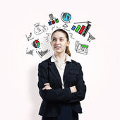 Young beautiful businesswoman dreaming — Stock Photo