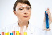 Attractive female scientist making tests — Stock Photo