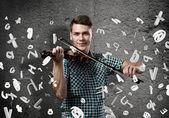 Virtuoso plays violin — Stock Photo