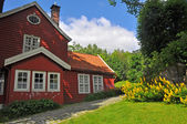 Typcial scandinavian red wooden house in norway — Stock Photo