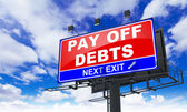 Pay off Debts on Red Billboard. — Stock Photo