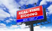 Real Time Bidding on Red Billboard. — Stock Photo
