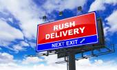 Rush Delivery on Red Billboard. — Stock Photo