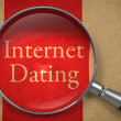 Internet Dating through Magnifying Glass. — Stockfoto #52300575