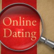 Online Dating through Magnifying Glass. — Stockfoto #52301525