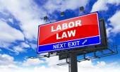 Labor Law on Red Billboard. — Stock Photo
