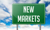 New Markets on Highway Signpost. — Stock Photo