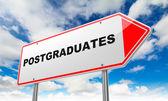 Postgraduates on Red Road Sign. — Stock Photo