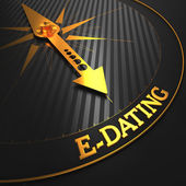E-Dating on Golden Compass Needle. — Stock Photo