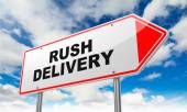 Rush Delivery on Red Road Sign. — Stock Photo
