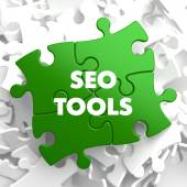 SEO Tools on Green Puzzle. — Stock Photo