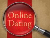 Online Dating through Magnifying Glass. — Stock Photo