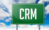 CRM on Green Highway Signpost. — Stock Photo