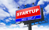 Startup Inscription on Red Billboard. — Stock Photo