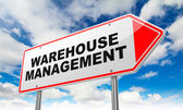 Warehouse Management on Red Road Sign. — Stockfoto