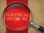 Political Pressure through Magnifying Glass. — Stock Photo