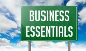 Business Essentials on Highway Signpost. — Foto Stock