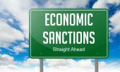 Economic Sanctions on Highway Signpost. — Stock Photo