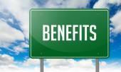 Benefits on Highway Signpost. — Stock Photo