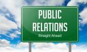 Public Relations on Highway Signpost. — Stockfoto