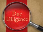 Due Diligence through Magnifying Glass. — Stock Photo