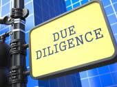 Due Diligence. Signpost on Blue Background. — Stock Photo