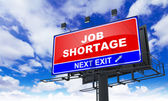 Job Shortage Inscription on Red Billboard. — Stock Photo