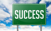 Success on Green Highway Signpost. — Stock Photo