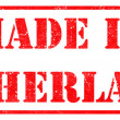 Made in Netherlands - Red Rubber Stamp. — Stock Photo #56327177