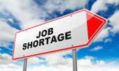 Job Shortage on Red Road Sign. — Stock Photo