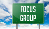 Focus Group on Green Highway Signpost. — Stock Photo