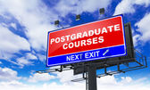 Postgraduate Courses on Red Billboard. — Stock Photo