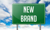 New Brand on Highway Signpost. — Foto Stock