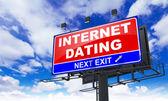 Internet Dating on Red Billboard. — Stock Photo
