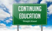 Continuing Education on Highway Signpost. — Stock Photo
