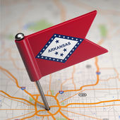 Arkansas Small Flag on a Map Background. — Stock Photo
