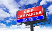 Drip Campaigns on Red Billboard. — Stock Photo