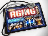Aging on the Display of Medical Tablet. — Stock Photo